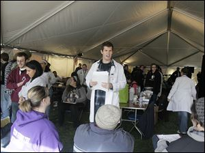Nick Morse, a fourth-year nursing student at Mercy College, calls for the next patient at last year's Tent City.