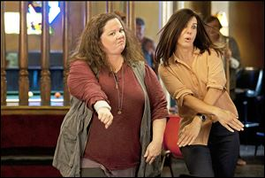 Detective Shannon Mullins (Melissa McCarthy, left) and FBI Special Agent Sarah Ashburn (Sandra Bullock) bust some moves during a night out on the town.