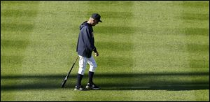 Tigers manager Jim Leyland walks across the outfield on Monday. Leyland admits to letting Game 2 get away from Detroit after a grand slam in the eighth and a game-winning single in the ninth.