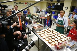 President Barack Obama speaks to reporters as he visits Martha's Table, which prepares meals for the poor and where furloughed federal employees are volunteering today in Washington.