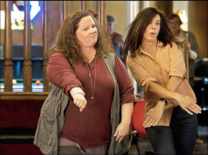 17THEHEAT.jpg Detective Shannon Mullins (Melissa McCarthy, left) and FBI Special Agent Sarah Ashburn (Sandra Bullock) bust some moves during a night out on the town.