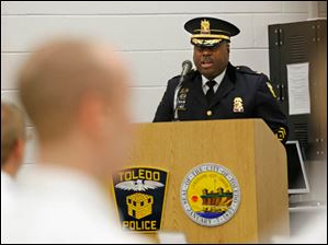 Toledo Police Chieg Derrick Diggs addresses the 61st Toledo Police Department Basic Police Officer Academy class.