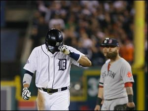 Detroit Tigers' Victor Martinez leaves for a pinch runner after hitting a single in the ninth inning.