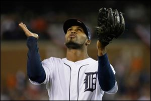 Detroit Tigers' Al Alburquerque looks up at the end of top of the ninth inning.