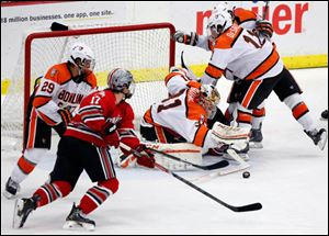 Bowling Green State University goalie Tommy Burke (32) blocks a shot against Ohio State.