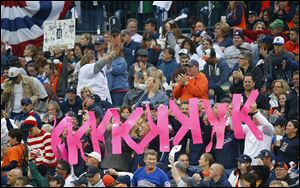 Fans hold up K signs after the Tigers' Justin Verlander strikes out Jarrod Saltalamacchia in the fifth inning. Verlander struck out 10 batters in Game 3 and allowed only one run, but took the loss.