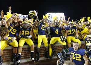 Michigan players celebrate their 41-30 win over Notre Dame at Michigan Stadium on Sept. 7. It was one of the few big nonconference wins for the Big Ten.