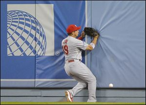 St. Louis Cardinals' Jon Jay can't come up with a ball hit by Los Angeles Dodgers' A.J. Ellis during the fifth inning.