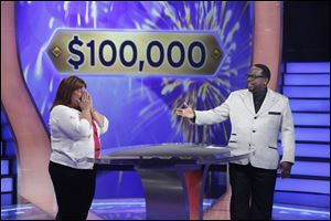 Tracey Launder of Rossford reacts with host Cedric 'The Entertainer' after winning $100,000 on 'Who Wants to be a Millionaire.'
