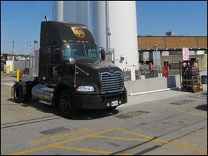 A UPS truck is parked and ready for fuel at a Liquified Natural Gas station. The shipping giant plans to build one at its Maumee cargo facility on Holland Road.