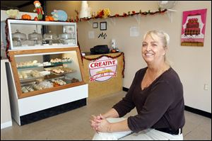 Kathy Nagypaul in her shop, Creative Cupcakes is among the business owners promoting the Secor Open Road Party in the Westgate area to celebrate the end of  the thoroughfare's reconstruction.