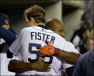 Detroit Tigers' Doug Fister is hugged by Torii Hunter after the sixth inning.
