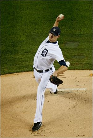 Detroit Tigers starting pitcher Doug Fister throws in the first inning during.
