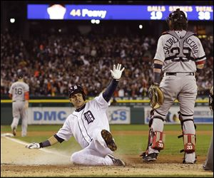 Detroit's Jose Iglesias scores on a double by Torii Hunter in the second inning of Game 4 of the American League Championship Series.