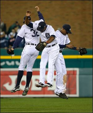 Detroit Tigers' Don Kelly, Torii Hunter, middle, and Austin Jackson celebrate after Game 4.
