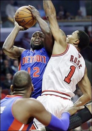 Detroit 's Will Bynum shoots against Chicago's Derrick Rose.