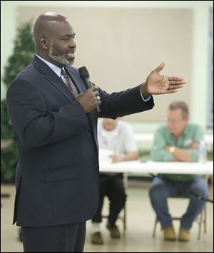 Mayor Mike Bell answers a question during the Point Place Business Association's Annual Meet the Candidates Forum on Wednesdayat the  Friendship Park Community Center in Point Place.
