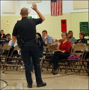 Sylvania police Sgt. Justin Music speaks to parents at Sylvan Elementary School about cyber bullying.