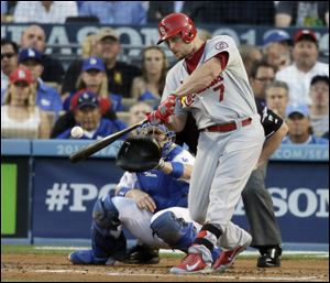 St. Louis Cardinals' Matt Holliday hits a two-run home run during the third inning.