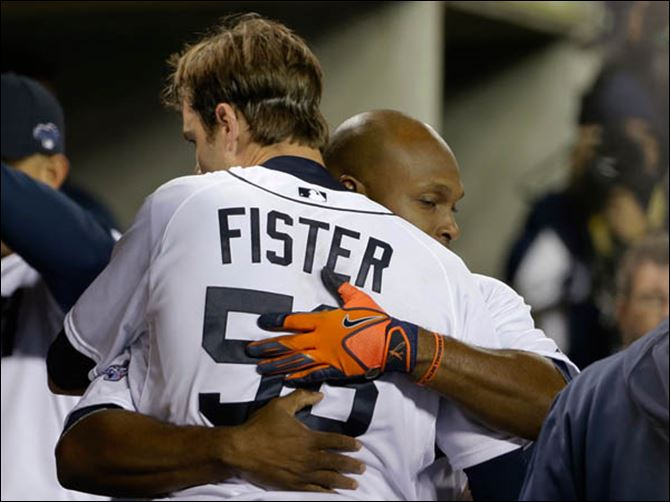ALCS Red Sox Tigers Baseball Detroit Tigers' Doug Fister is hugged by Torii Hunter after the sixth inning.