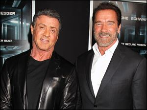 "Sylvester Stallone, left, and Arnold Schwarzenegger attend the premiere of ""Escape Plan"" at the Regal E-Walk on Tuesday in New York."