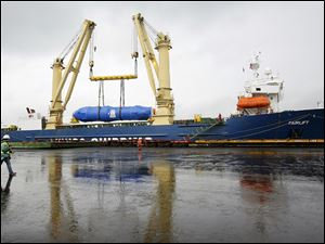 New steam generators for the Davis-Besse nuclear power plant are transferred from ship to rail.