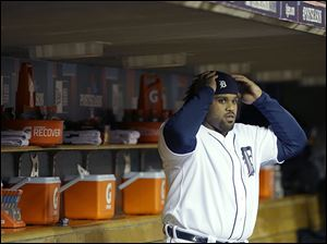 The Tigers' Prince Fielder gets ready in the dugout before the start of Game 5 of the American League championship series on Thursday. Fielder is a career .197 postseason hitter.