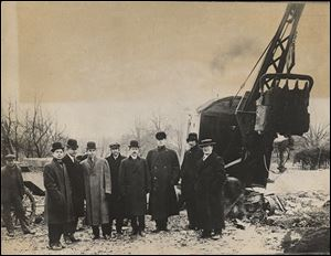 Construction of Scott High School began on Jan. 3, 1911. In front of a steam shovel are representatives of the Toledo school board and contractors.