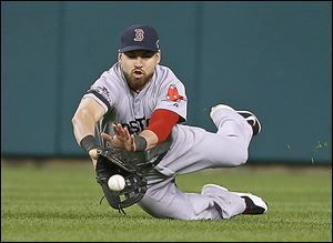 Boston's Jacoby Ellsbury dives for a ball hit by the Tigers' Omar Infante in the sixth inning.