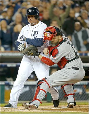 The Tigers' Miguel Cabrera is tagged out at home by Red Sox catcher David Ross in the first inning during Game 5 of the American League championship series on Thursday.