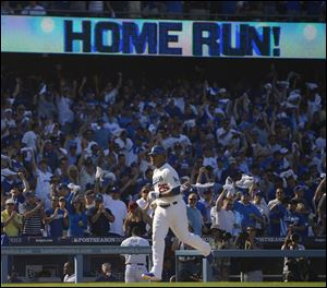 Los Angeles Dodgers' A.J. Ellis hits a home run during the seventh inning.