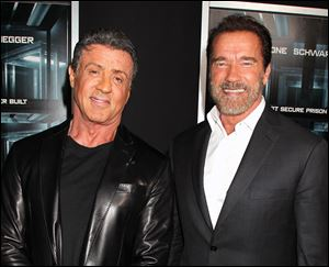 Sylvester Stallone, left, and Arnold Schwarzenegger attend the premiere of