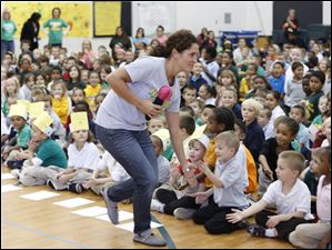Tara Stubleski, special education teacher at Navarre Elementary, slaps fives with students.