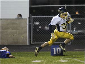 Toledo Christian junior Caleb Wotring runs to the end zone for a touchdown.