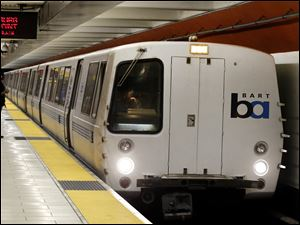 A Bay Area Rapid Transit train arrives at a station earlier this week in Oakland, Calif.