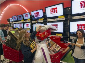 Shopper Roxanna Garcia, middle, waits in line to pay for  her over a $1000.00 gifts at the Target store in Burbank, Calif. in November, 2012.