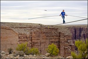 Nik Wallenda nears the completion of his 1,400-foot walk across the Grand Canyon for Discovery Channel's Skywire Live With Nik Wallenda in June.