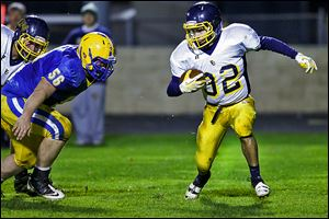 Toledo Christian's Caleb Wotring, right, runs past Northwood's Myles Habel chases on Friday. The junior finished with 133 yards.