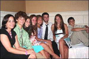 Diane Wlodarski, a former kindergarten teacher, had seven children. From left are Anna, Luke, Katherine, Abby, Ms. Wlodarski, Sam, Alise, and Matthew Wlodarski.