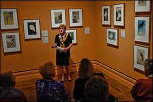 Docent Mary Galvin gives a tour of the exhibit