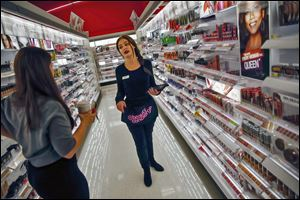 Target beauty concierge Chelsea Mathison helps Bethany Miller find tea tree oil, which is not found in the cosmetics aisle. Target has instituted the beauty service in 200 stores nationwide.