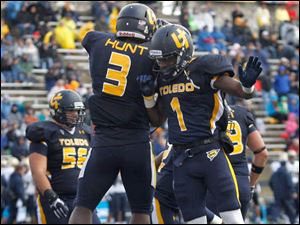 Kareem Hunt, 3, and Bernard Reedy celebrate Hunt's touchdown during 2nd half.