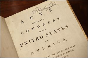 'Acts Passed at a Congress of the United States of America,' which belonged to George Washington and features his signature at the top right, now resides in the Rare Books Vault of the new library.