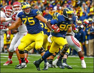 Michigan quarterback Devin Gardner, who completed 21 of 29 passes for 503 yards, runs for a touchdown against Indiana.