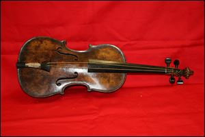 "A violin believed to be the one played by Titanic bandmaster Wallace Hartley. It's a poignant scene familiar to anyone who has watched ""Titanic""  as the ship slides into the icy waters, musicians perform for the passengers, playing with stoic resolve until the final hour."