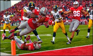 Ohio State's Carlos Hyde, who rushed for 149 yards, dives for a touchdown against Iowa in the fourth quarter on Saturday.