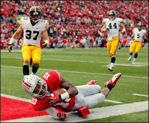 Ohio State WR Corey Brown (10) scores a touchdown against Iowa during the second quarter.