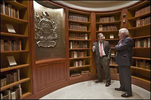 Doug Bradburn, founding director of the Fred W. Smith National Library for the Study of George Washington, left, talks with Curt Viebranz, president and CEO of George Washington's Mount Vernon Estate, Museum, and Gardens, in the Rare Books Vault of the new library in Virginia.