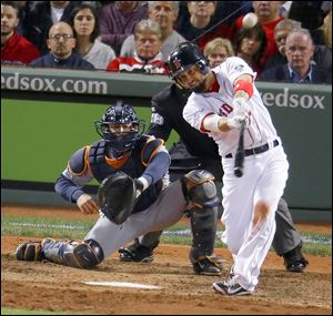 Boston's Shane Victorino hits a grand slam off Detroit's Jose Veras in the seventh inning of Game 6 of the American League Championship Series. The Red Sox beat the Tigers to reach the World Series where they will face the St. Louis Cardinals.