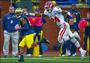 Michigan's Jeremy Gallon hauls in a pass and runs for a touchdown against Indiana's Tim Bennett. Gallon set a Big Ten record with 369 receiving yards.